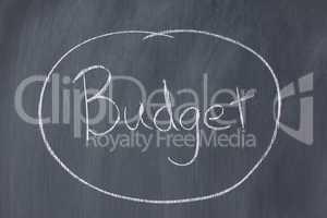 "Word ""budget"" circled on a blackboard"