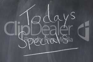 "Blackboard with words ""todays specials"" written on it"