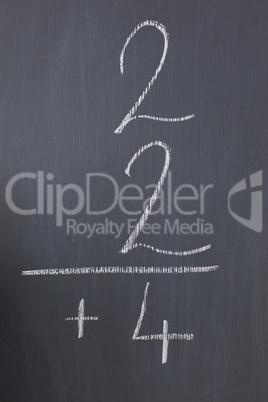 Blackboard with a simple fraction written on it