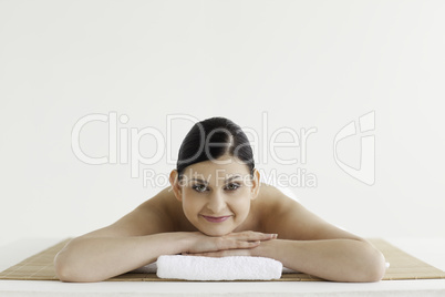Brunette getting a spa treatment while looking at the camera