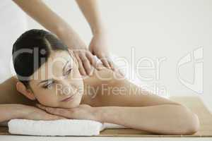 Pretty dark-haired woman enjoying a massage
