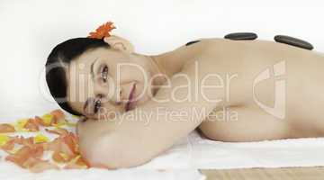 Pretty brunette enjoying the procedure of massage