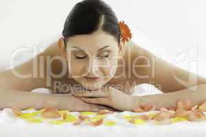 Beautiful dark-haired woman enjoying the relaxation