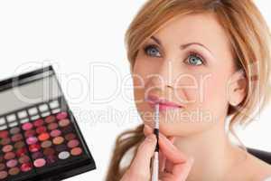 woman getting make up