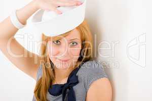 Young marine woman fashion portrait sailor hat