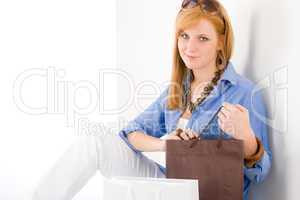 Shopping young woman with paper bag