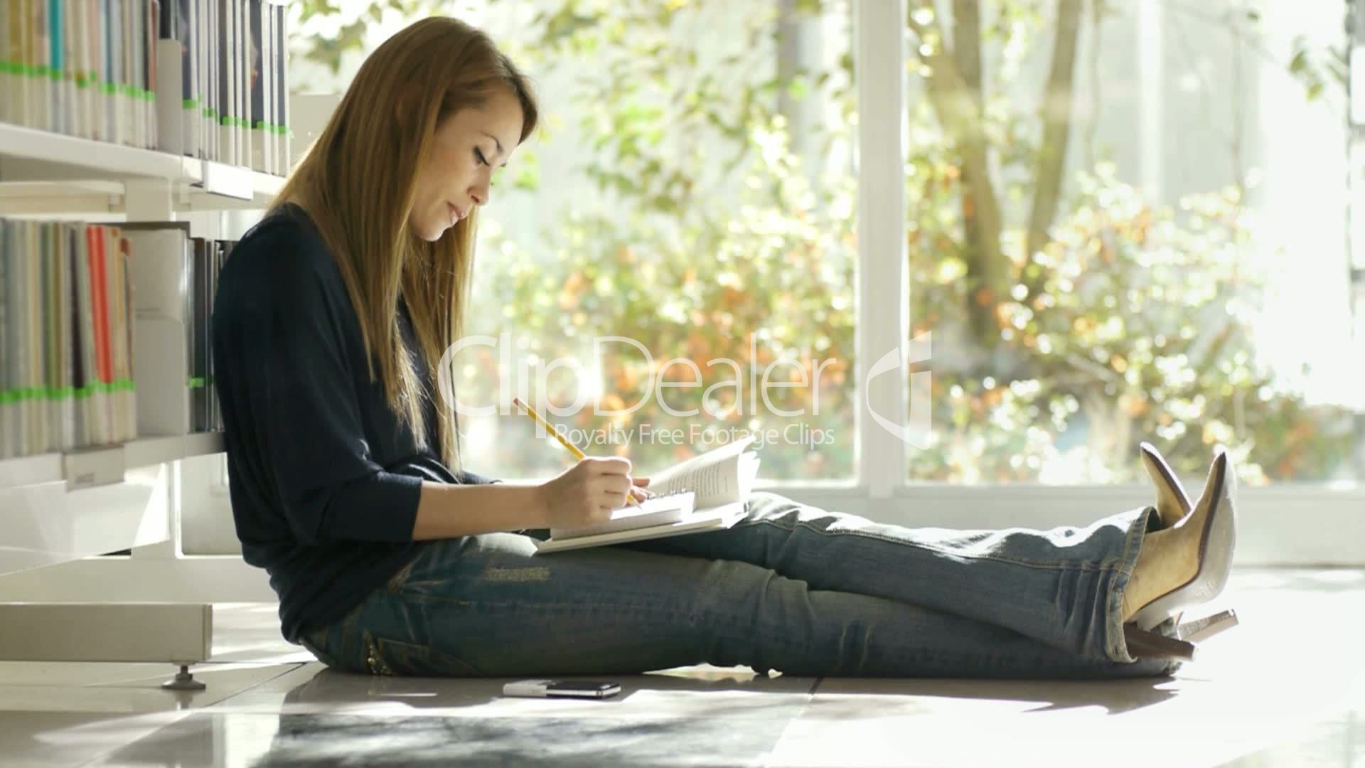 Girl Studying On Floor In Library Royalty Free Video And Stock Footage