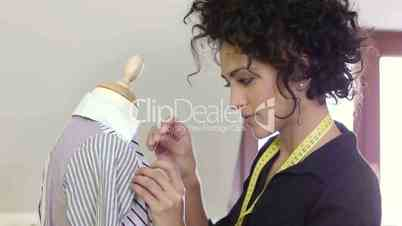 Woman working in fashion design studio