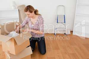 Blond-haired woman preparing to move house