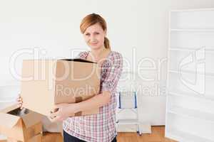 Attractive woman carrying cardboard boxes