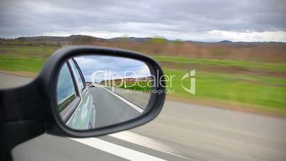Car driving look back from mirror