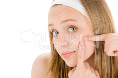Acne facial care teenager woman squeezing pimple