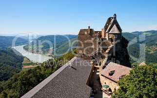 Roofs and towers of Aggstein medieval castle on Danube valley background