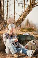 Camping young woman search navigation compass map