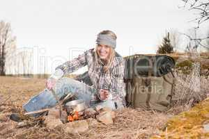 Campfire hiking woman with backpack cook country