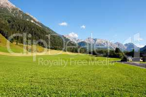Alpine rural landscape: mountains and meadows