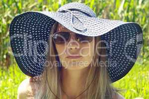 girl in blue hat and spectacles