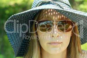 portrait blonde girl in hat