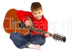 The boy with an acoustic guitar on a white background