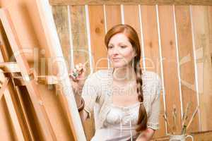 Red-hair romantic woman in barn painting portrait