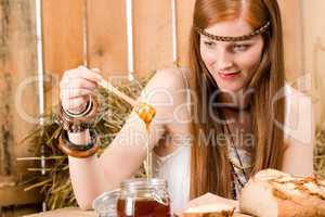 Red-hair young hippie woman have breakfast in barn