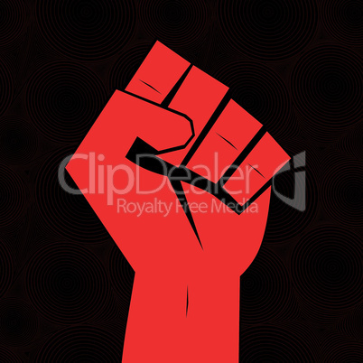 Clenched fist hand held high in protest