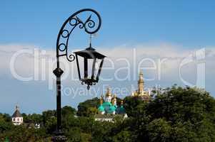 Retro street lantern and golden domes of Kiev Pechersk Lavra Monastery in Kiev, Ukraine