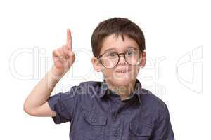 Little boy in round spectacles raising finger in attention gesture isolated
