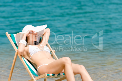 Summer slim woman sunbathing in bikini deckchair