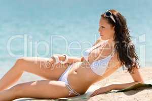 Summer beach stunning woman sunbathing in bikini