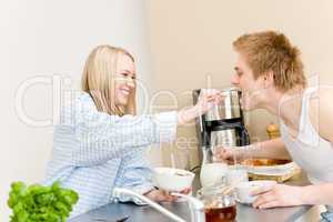 Breakfast happy couple woman feed man cereal