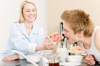 Breakfast happy couple man feed woman toast