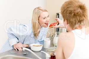 Breakfast happy couple man feed woman toast