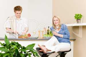 Lunch happy couple prepare salad in kitchen