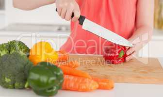 Woman cutting some vegetables in the kitchen