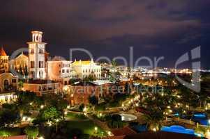 Night illumination of luxury hotel during sunset and Playa de la
