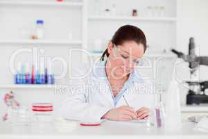 Young scientist writting a report