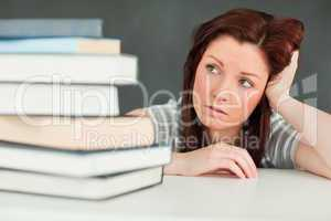 Young student looking at the amount of books she has to read