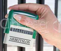 Arbeitslos - Stempel mit Hand