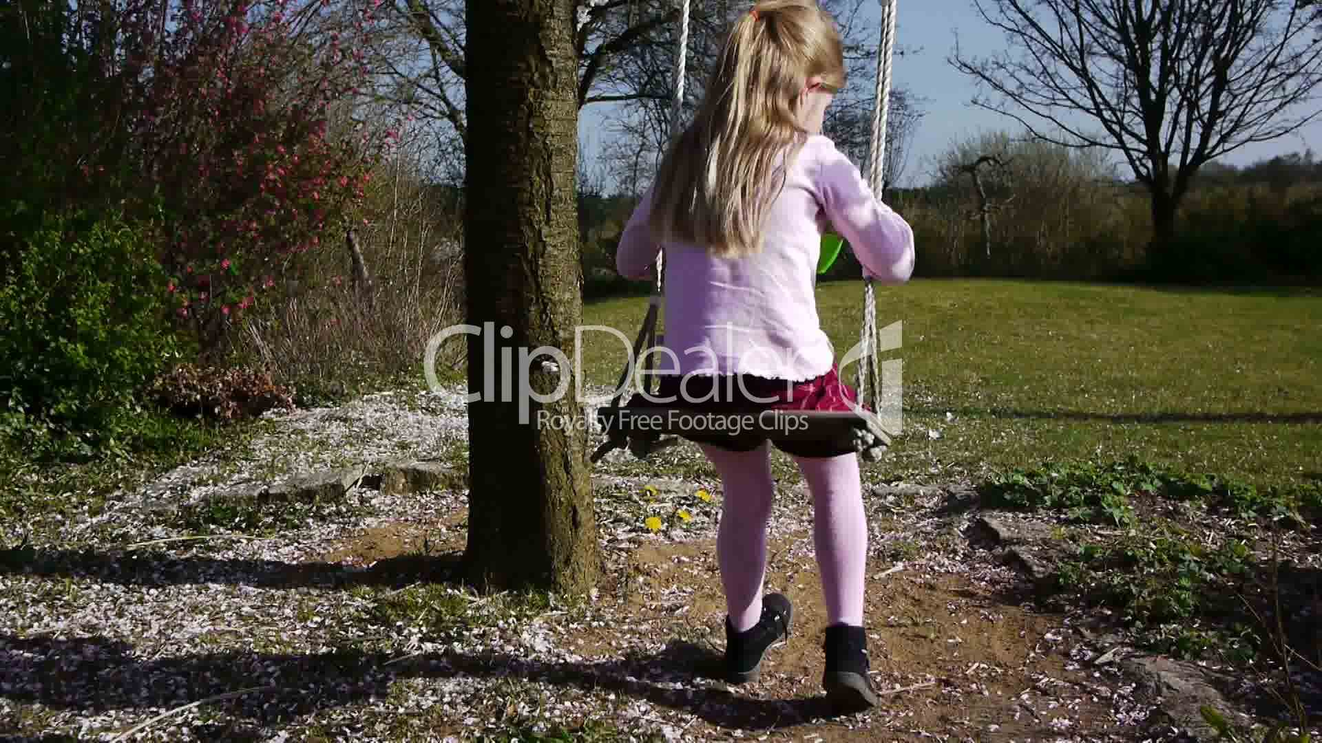 Little Girl Sitting On A Swing Royalty Free Video And