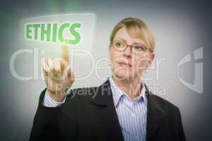 Woman Pushing Ethics Button on Interactive Touch Screen