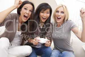 Three Beautiful Women Friends Playing Video Games at Home
