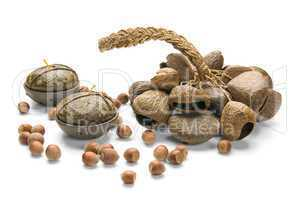 Still-life, Ethnic Musical Instrument, nuts and Candles, isolate