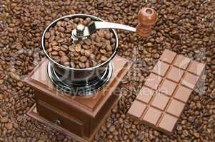 Old coffee grinder and Chocolate