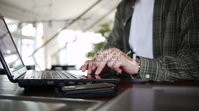Male with Notebook clicking