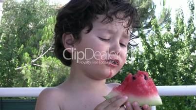 Litttle Boy eating watermelon
