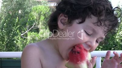 Little boy likes watermelon