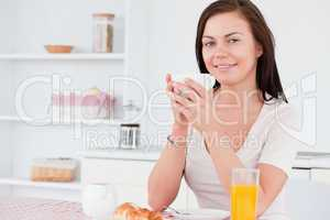 Woman having her breakfast