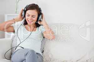 Charming brunette listening to music
