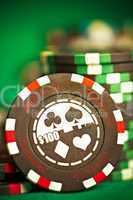 gambling chips on green cloth